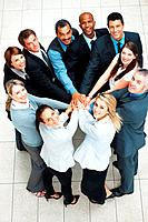 Top view of colleagues with hands piled on top
