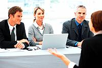 Panel of executives interviewing a woman