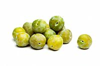 Whole fresh greengage plums on white background