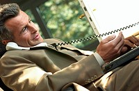 businessman with phone and notebook