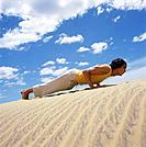Man Doing Push_Ups in Sand