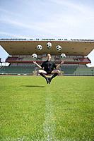 Soccer Referee Juggling Balls While Floating