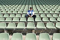 Fan Sitting in Empty Stadium