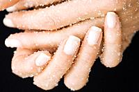 Woman Rubbing Her Hands with Salt
