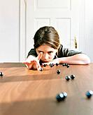 Girl Playing Marbles