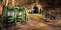minecart and a gated entrance of an adit , Germany, North Rhine_Westphalia, Ruhr Area, Witten