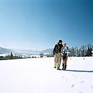 Family Walking in Snow Field