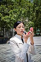 Businesswoman Using Compact