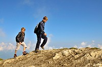 two boys hiking at Nebelhorn, Germany, Bavaria, Allgaeuer Alpen