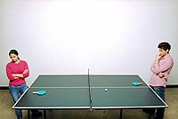 Couple Standing at Ping Pong Table