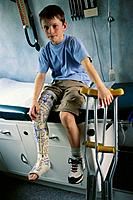 Boy With Cast on Leg