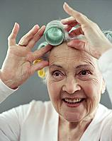 Elderly Woman Putting Rollers in Her Hair