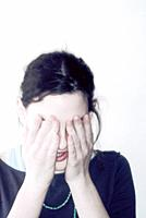 Adolescent Girl Covering Face
