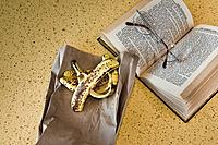 Glasses, book, and a banana peel