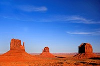 panoramic view into Monument Valley with its famous sandstone buttes East Mitten, West Mitten and Merrick in evening light, USA, Arizona, Monument Val...