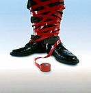 Businessman´s Legs Tied in Tape