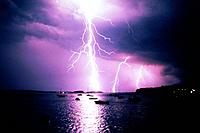 Lightning Striking Over Water
