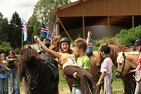 Islandic horse, Iceland pony Equus przewalskii f. caballus, Boy congratulating the Winner of a Horse Race