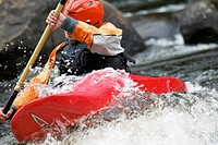 Woman Kayaking in White Water.
