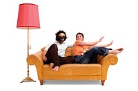 couple fooling around on a sofa, Germany