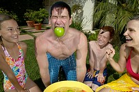 Family Bobbing for Apples