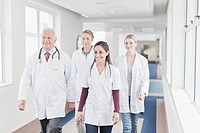 Doctors and nurses walking in hospital