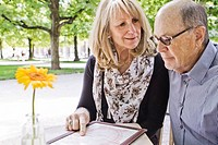 Older couple reading menu at cafe