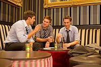 Businessmen having drinks in lounge