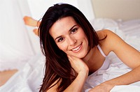 Young Smiling Woman Lying in Bed