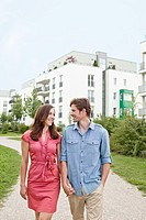 Couple walking hand_in_hand outdoors