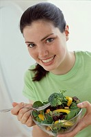 Teenage Girl Eating Salad