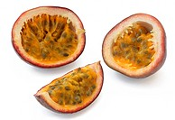 Sections of passion fruit cut in three different ways, on a white background.