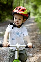 Toddler boy riding bike