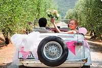Newlyweds in classic car (thumbnail)