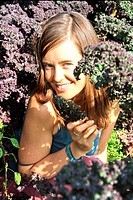 Woman who lost 165 lbs being a Raw Foodist in a field of locally grown kale at Two EE´s Organic Produce in Surrey, British Columbia