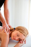 Young woman being massaged