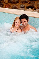 Young couple in hot tub, portrait