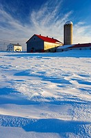 A farm in winter at sunset, Bas_Saint_Laurent region, Saint_Arsene, Quebec