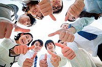 Businesspeople in a circle with thumbs up