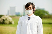 Portrait of young man wearing pollution mask and glasses