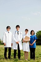 Male doctors and female nurses in field