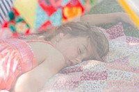 Young girl sleeping in summer netting tent