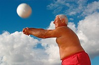 Paunchy Man Bumping a Volleyball