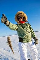 Woman ice fishing, Preissac Lake, Quebec