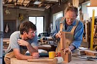 Caucasian men working in carpentry workshop