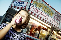Girl Eating at Amusement Park, CNE, Toronto, Ontario