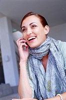 Laughing Young Woman Talking on Cell Phone