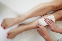 Woman Having Legs Waxed