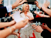 Female Star and Adoring Fans