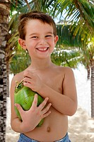 A five Years old with a coconut